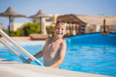 Kid swimming and playing in pool. summertime Royalty Free Stock Image