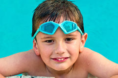 Kid in the swimming pool stock images