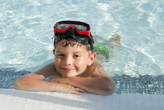 Kid into the swimming pool Stock Photo