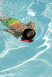 Kid into the swimming pool Royalty Free Stock Photo