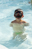 Kid into the swimming pool Royalty Free Stock Image