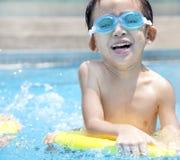 Kid in Swimming Pool Royalty Free Stock Image