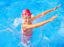 Kid swimming in pool. Stock Photography