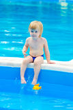 Kid by the swimming pool Royalty Free Stock Images