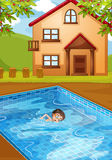 A kid swimming at the pool Stock Photography