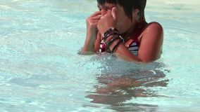 Kid in a swimming pool stock footage