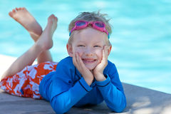 Kid by the swimming pool Stock Image