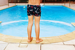 Kid and swimming pool Stock Photography