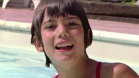 Kid in a swimming pool stock video