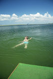 Kid swimming in sea Royalty Free Stock Photography