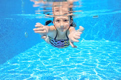 Kid swims in pool underwater Royalty Free Stock Images