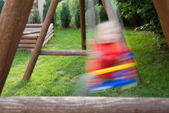 Kid on the swing Stock Photography