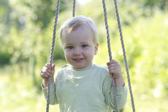 Kid on swing Royalty Free Stock Photography