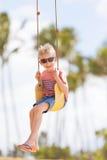 Kid at swing Royalty Free Stock Photos