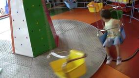 Kid on the swing. Having fun video stock video footage