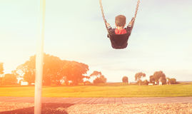 Kid on a swing. Stock Photos