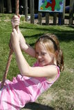 Kid swinging. Pretty white caucasian girl having fun on a swing Royalty Free Stock Images