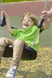 Kid Swinging royalty free stock photo