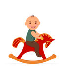 Kid swinging on a rocking horse. Royalty Free Stock Photos