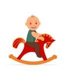 Kid swinging on a rocking horse. Royalty Free Stock Photos
