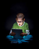 Kid with tablet Stock Photography