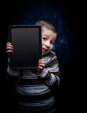 Kid with tablet Stock Photo
