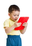 Kid with tablet computer, early learning conception. Kid boy with tablet computer, early learning conception royalty free stock photos
