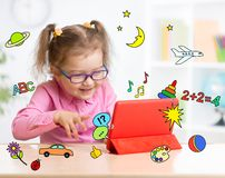 Kid with tablet computer in glasses. Early Stock Images