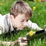 Kid with Tablet Computer Royalty Free Stock Photos