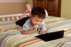 A kid on a tablet computer Stock Photo