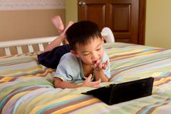 A kid on a tablet computer Stock Photography