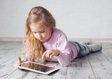 Kid with tablet pc Stock Photography