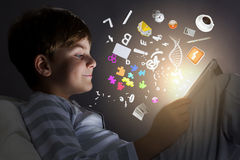 Kid with tablet pc Royalty Free Stock Photo