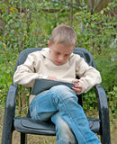 Kid with tablet pc. Stock Photography
