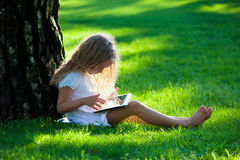 Kid with tablet pc outdoors Royalty Free Stock Images