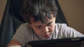Kid with tablet PC at the table Stock Image