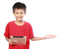 Kid with tablet presenting Royalty Free Stock Images