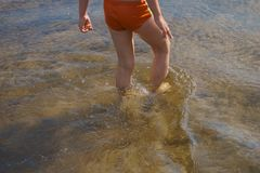 Kid take a walk in water Royalty Free Stock Photography