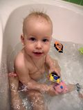 The kid takes a bath. Royalty Free Stock Image