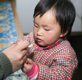 The kid taking medicine. The little girl been taking medicine Stock Photos