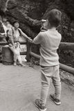Kid taking picture for mom Royalty Free Stock Photos