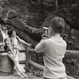 Kid taking picture for mom Stock Images