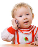 Kid talking on a cellular phone. Isolation on white Royalty Free Stock Photos