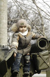 Kid on a tank Stock Photo