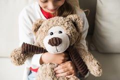 Kid with teddy bear Stock Photo