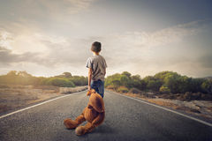 Kid with teddybear stock photos