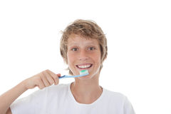 Kid or teen cleaning white healthy teeth Royalty Free Stock Images