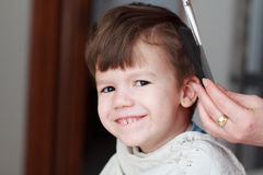 Kid with teeth smile haircut. Haircut for little boy, professional barber, teeth smile Stock Images