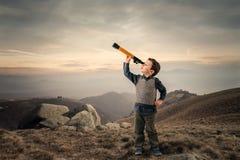 Kid with telescope stock photos