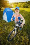 Kid with a tent on a camomile meadow Stock Images